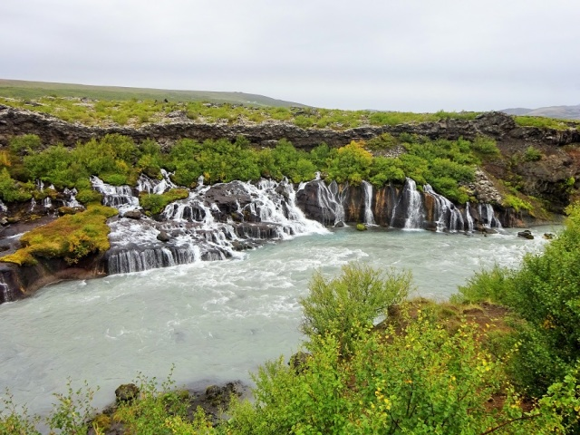Water gushes from the porous rock that is Hraunfossar